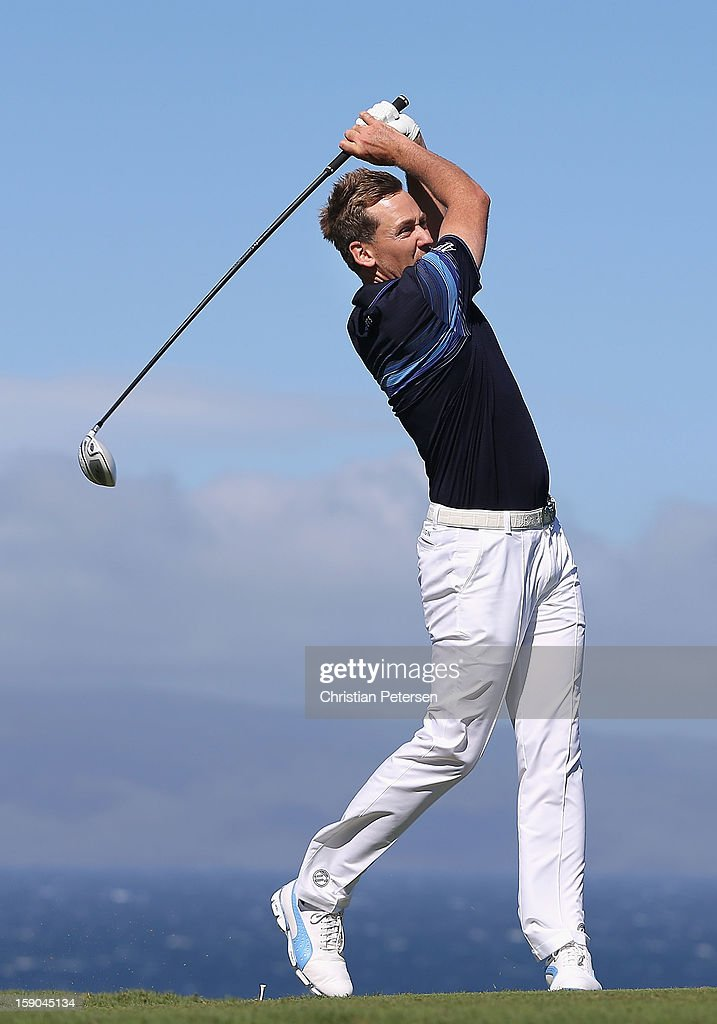 Ian Poulter of England hits a tee shot on the 10th hole during the replay of the first round of the Hyundai Tournament of Champions at the Plantation Course on January 6, 2013 in Kapalua, Hawaii.