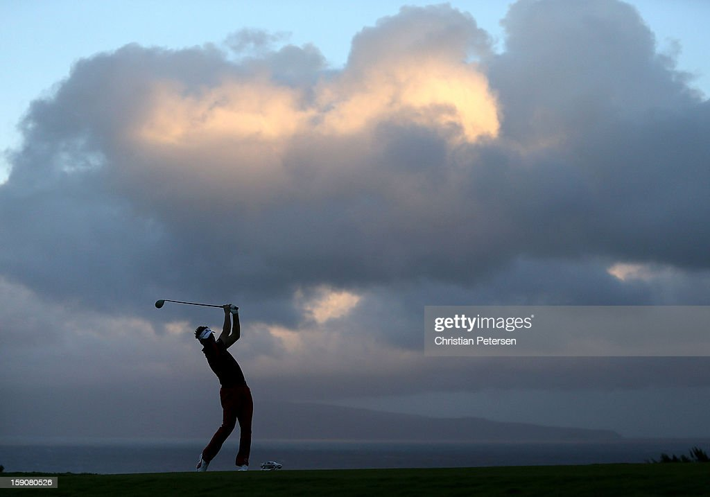 Ian Poulter of England hits a tee shot on the 10th hole during the replay of the first round of the Hyundai Tournament of Champions at the Plantation Course on January 7, 2013 in Kapalua, Hawaii.