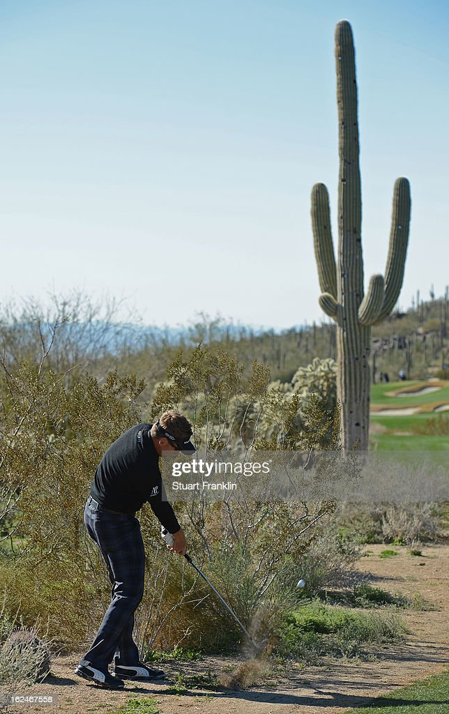 Ian Poulter of ENgland hits his approach shot on the 11th hole during the quarterfinal round of the World Golf Championships - Accenture Match Play at the Golf Club at Dove Mountain on February 23, 2013 in Marana, Arizona.