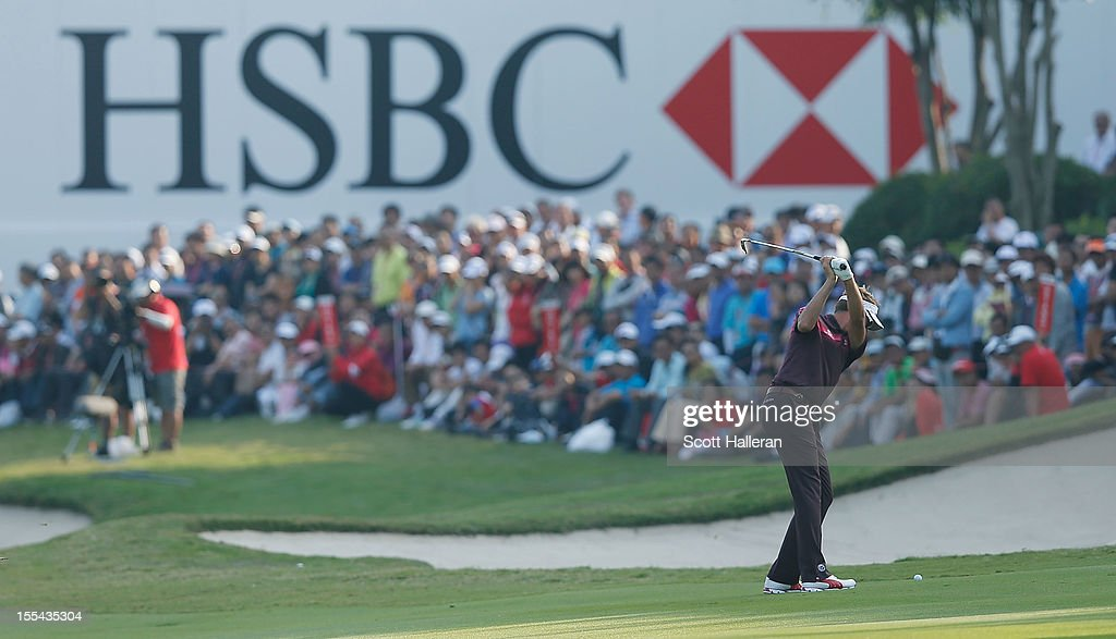 Ian Poulter of England hits his approach shot on the 18th hole during the final round of the WGC HSBC Champions at the Mission Hills Resort on November 4, 2012 in Shenzhen, China.