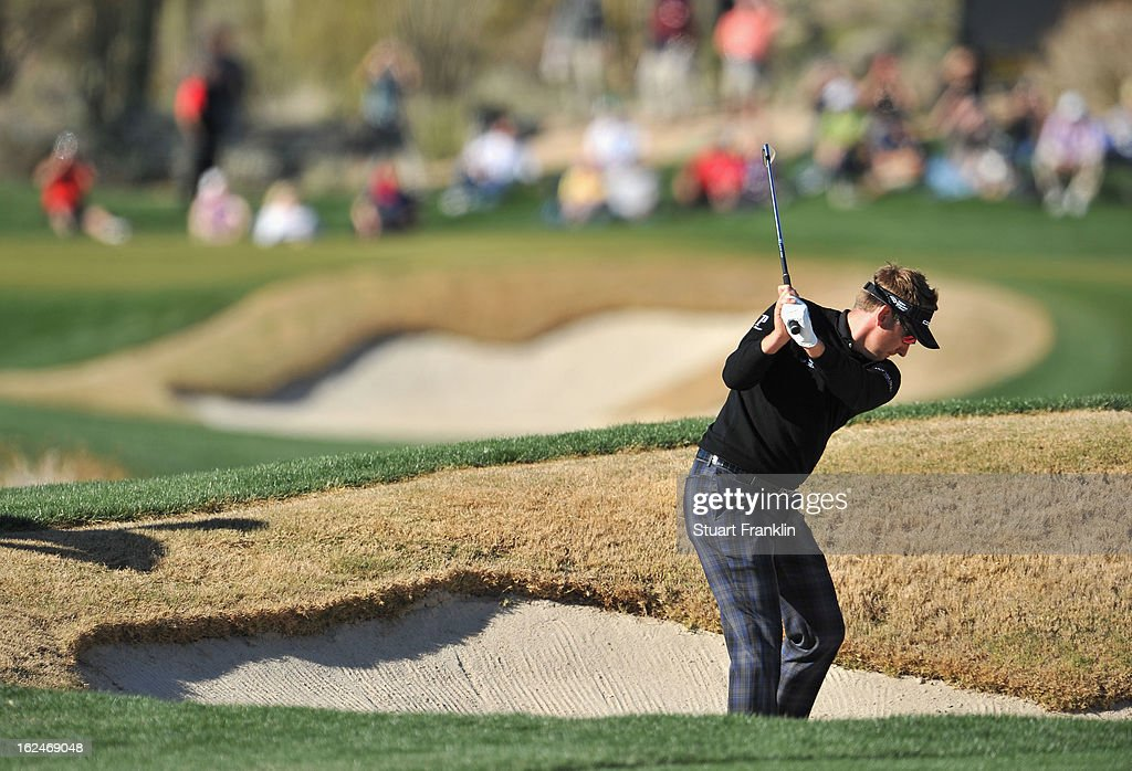 Ian Poulter of ENgland hits his bunker shot on the 14th hole during the quarterfinal round of the World Golf Championships - Accenture Match Play at the Golf Club at Dove Mountain on February 23, 2013 in Marana, Arizona.