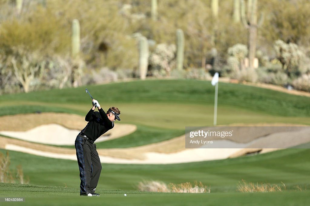 <a gi-track='captionPersonalityLinkClicked' href=/galleries/search?phrase=Ian+Poulter&family=editorial&specificpeople=171444 ng-click='$event.stopPropagation()'>Ian Poulter</a> of England hits his second shot on the par 4 14th hole during the third round of the World Golf Championships - Accenture Match Play against Tim Clark of South Africa at the Golf Club at Dove Mountain on February 23, 2013 in Marana, Arizona.