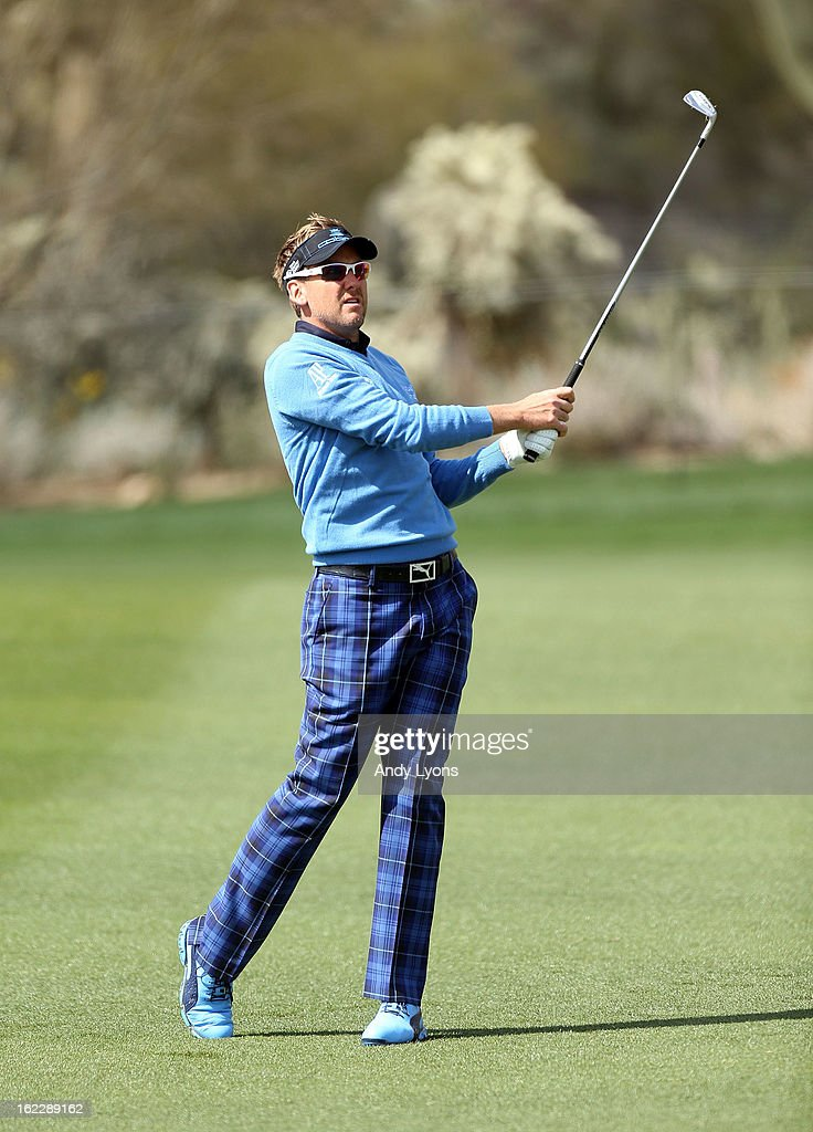 Ian Poulter of England hits his second shot on the par4 15th hole during his 2 up win over Stephen Gallacher of Scotland during the first round of the World Golf Championships - Accenture Match Play at the Golf Club at Dove Mountain on February 21, 2013 in Marana, Arizona. Round one play was suspended on February 20 due to inclimate weather and is scheduled to be continued today.
