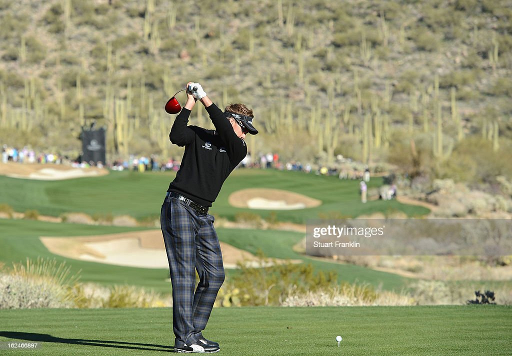 Ian Poulter of ENgland hits his tee shot on the 15th hole during the quarterfinal round of the World Golf Championships - Accenture Match Play at the Golf Club at Dove Mountain on February 23, 2013 in Marana, Arizona.