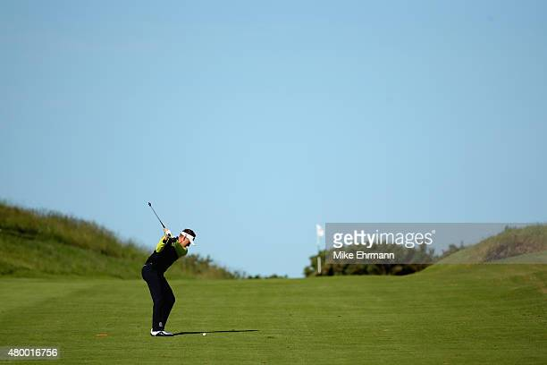 Ian Poulter of England hits his tee shot on the first hole during the first round of the Aberdeen Asset Management Scottish Open at Gullane Golf Club...