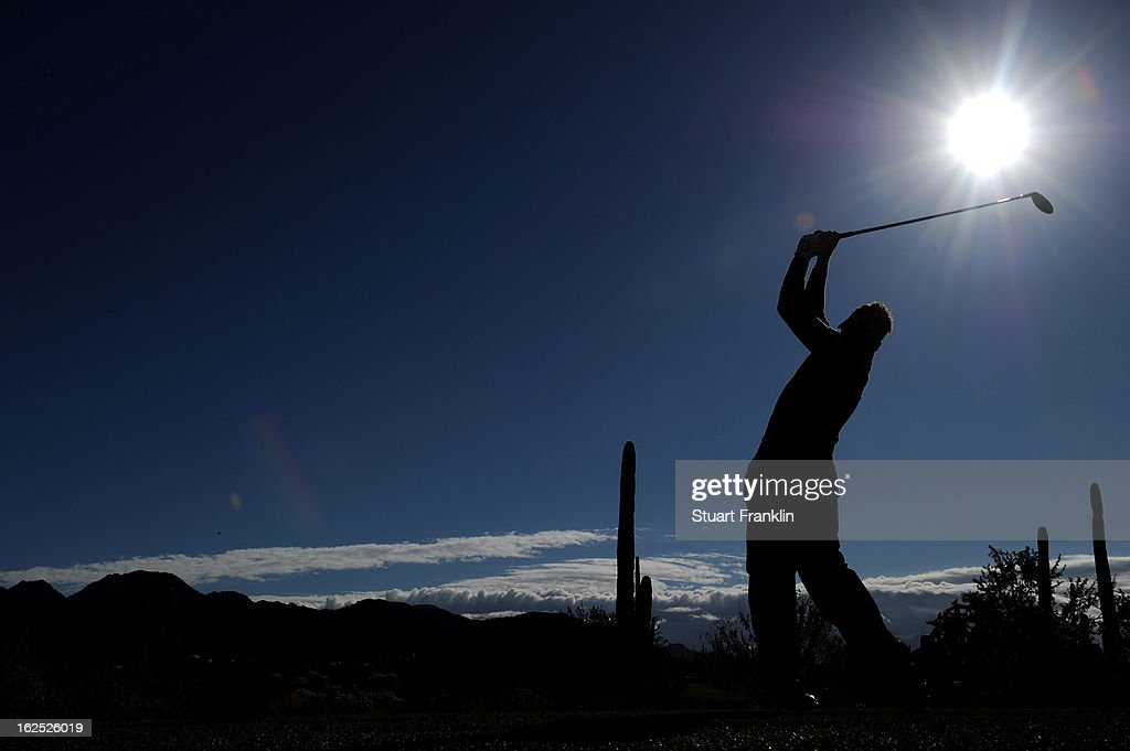 Ian Poulter of England hits his tee shot on the ninth hole during the semifinal round of the World Golf Championships - Accenture Match Play at the Golf Club at Dove Mountain on February 24, 2013 in Marana, Arizona.