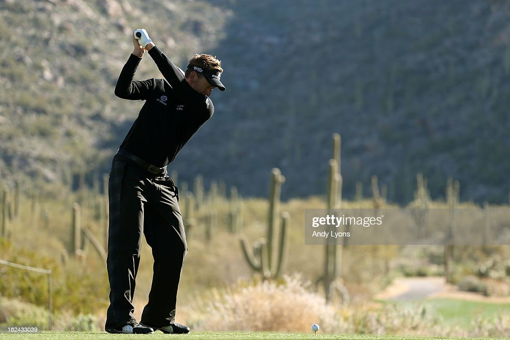 Ian Poulter of England hits his tee shot on the par 4 15th hole during the third round of the World Golf Championships - Accenture Match Play against Tim Clark of South Africa at the Golf Club at Dove Mountain on February 23, 2013 in Marana, Arizona.