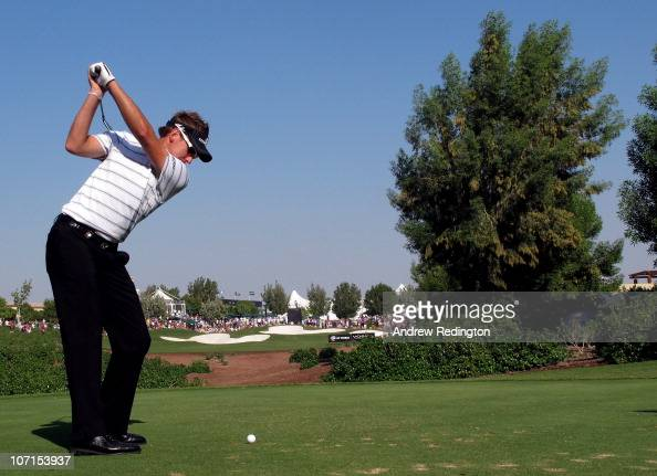 Ian Poulter of England hits his teeshot on the 13th hole during the second round of the Dubai World Championship on the Earth Course Jumeirah Golf...