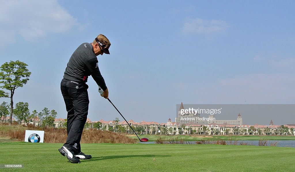 Ian Poulter of England hits his tee-shot on the ninth hole during the third round of the BMW Masters at Lake Malaren Golf Club on October 26, 2013 in Shanghai, China.