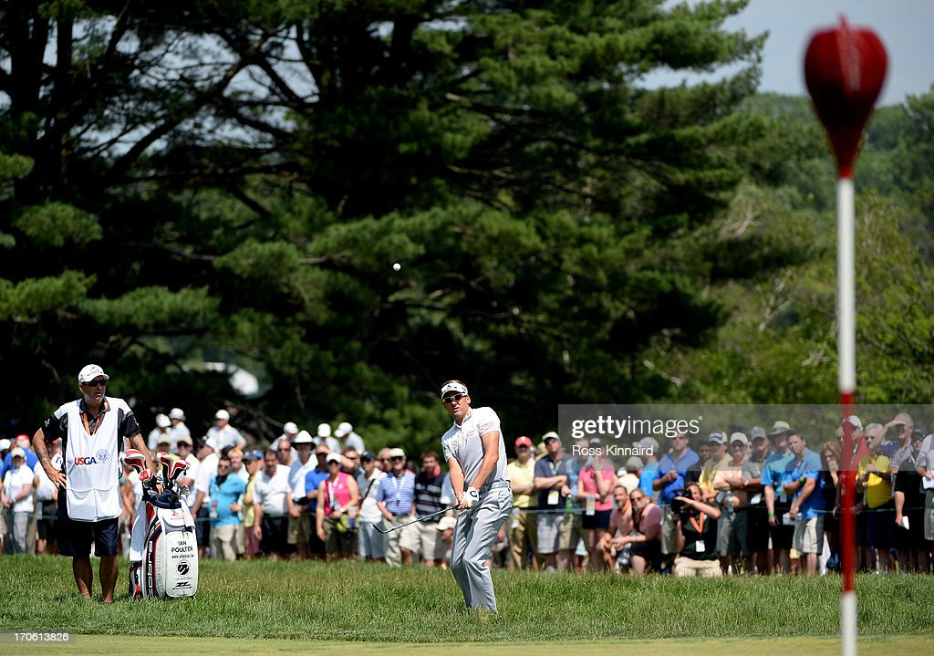 Ian Poulter of England hits his third shot on the second hole as caddie Terry Mundy looks on during Round Three of the 113th U.S. Open at Merion Golf Club on June 15, 2013 in Ardmore, Pennsylvania.