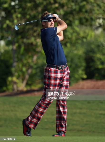Ian Poulter of England hits his third shot on the tenth hole during the third round of the Dubai World Championship on the Earth Course Jumeirah Golf...