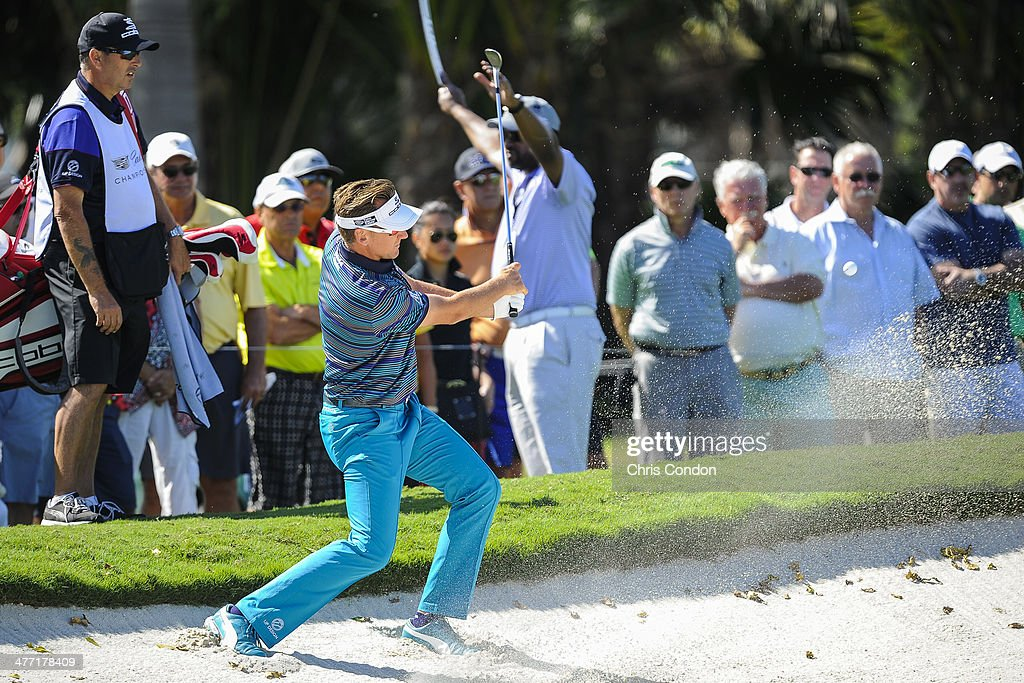 Ian Poulter of England hits out of a bunker on the seventh hole during the second round of the World Golf Championships-Cadillac Championship at Blue Monster, Trump National Doral, on March 7, 2014 in Doral, Florida.