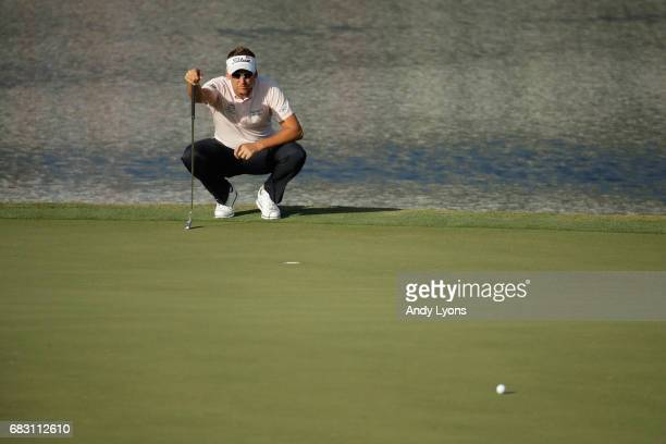 Ian Poulter of England lines up a putt on the 17th green during the final round of THE PLAYERS Championship at the Stadium course at TPC Sawgrass on...