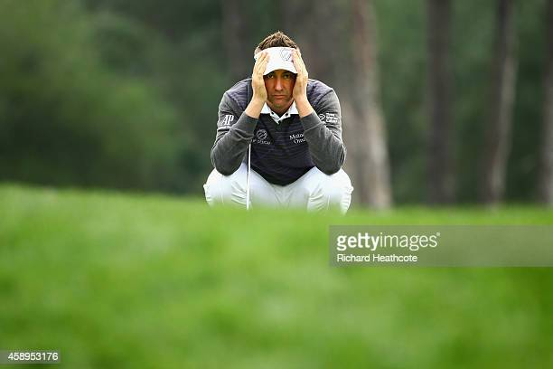 Ian Poulter of England lines up a putt on the 1st green during the second round of the 2014 Turkish Airlines Open at The Montgomerie Maxx Royal on...