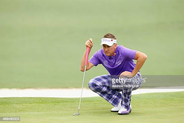 Ian Poulter of England lines up a putt on the second hole during the final round of the 2015 Masters Tournament at Augusta National Golf Club on...