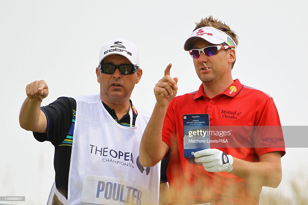 Ian Poulter of England lines up a shot with Terry Munday during the third round of the 141st Open Championship at Royal Lytham & St. Annes Golf Club on July 21, 2012 in Lytham St Annes, England.