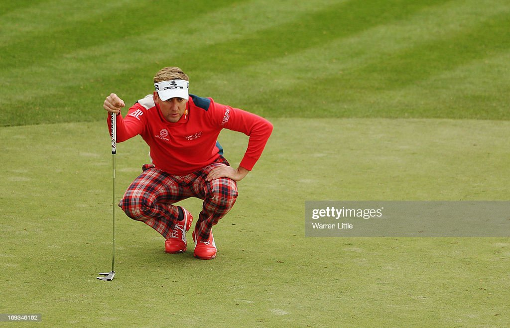 <a gi-track='captionPersonalityLinkClicked' href=/galleries/search?phrase=Ian+Poulter&family=editorial&specificpeople=171444 ng-click='$event.stopPropagation()'>Ian Poulter</a> of England lines up on the 18th green during the first round of the BMW PGA Championship on the West Course at Wentworth on May 23, 2013 in Virginia Water, England.