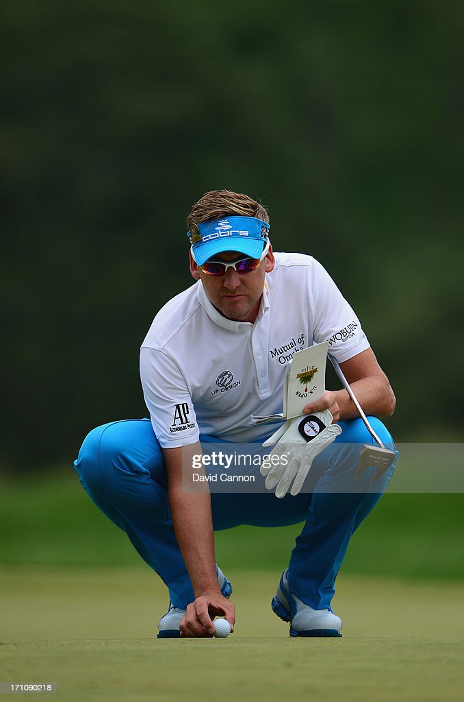 Ian Poulter of England makes his ball during the final round of the 113th U.S. Open at Merion Golf Club on June 16, 2013 in Ardmore, Pennsylvania.