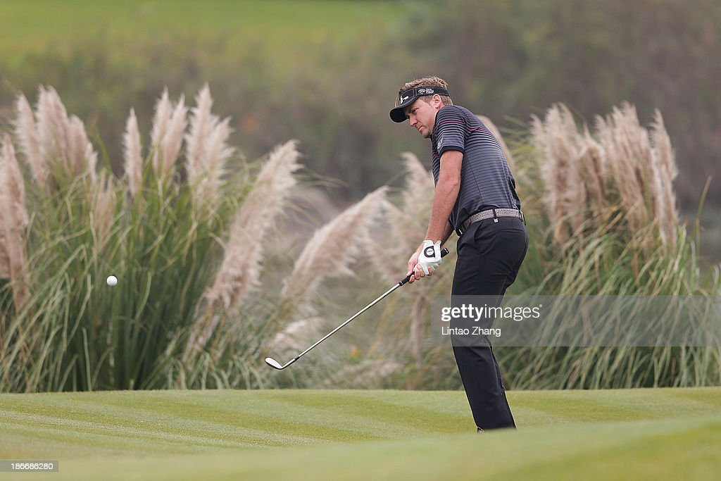 Ian Poulter of England plays a shot during the final round of the WGC - HSBC Champions at the Sheshan International Golf Club on November 3, 2013 in Shanghai, China.