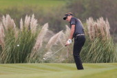 Ian Poulter of England plays a shot during the final round of the WGC HSBC Champions at the Sheshan International Golf Club on November 3 2013 in...