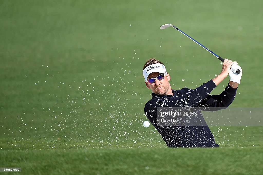 Ian Poulter of England plays a shot from a bunker on the second hole during the second round of the 2016 Masters Tournament at Augusta National Golf...