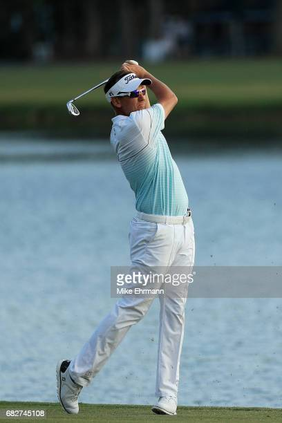 Ian Poulter of England plays a shot on the 18th hole during the third round of THE PLAYERS Championship at the Stadium course at TPC Sawgrass on May...