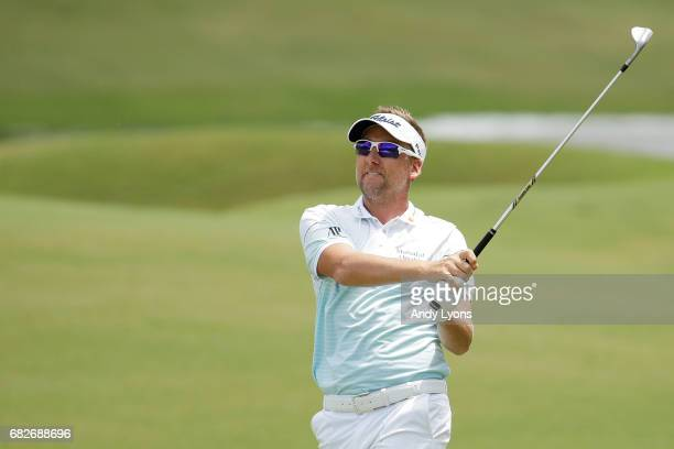 Ian Poulter of England plays a shot on the first hole during the third round of THE PLAYERS Championship at the Stadium course at TPC Sawgrass on May...