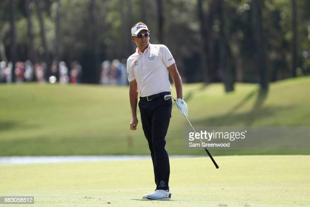 Ian Poulter of England plays a shot on the seventh hole during the final round of THE PLAYERS Championship at the Stadium course at TPC Sawgrass on...