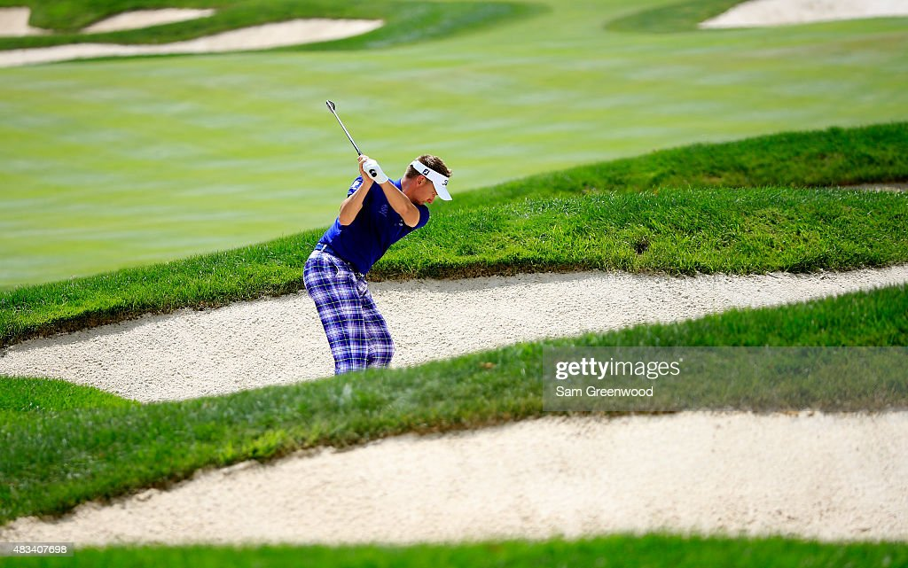 Ian Poulter of England plays a shot out of a bunker on the second hole during the third round of the World Golf Championships - Bridgestone Invitational at Firestone Country Club South Course on August 8, 2015 in Akron, Ohio.