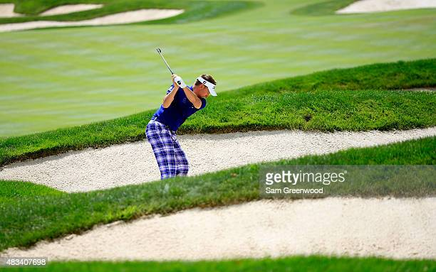 Ian Poulter of England plays a shot out of a bunker on the second hole during the third round of the World Golf Championships Bridgestone...