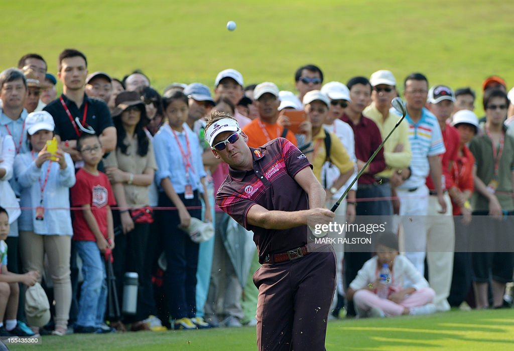 Ian Poulter of England plays from the rough at the 17th hole before winning the WGC-HSBC Champions tournament held on the Olazabal Course at the Mission Hill Golf Club in Dongguan on November 4, 2012. Poulter finished on 21 under par. AFP PHOTO/Mark RALSTON