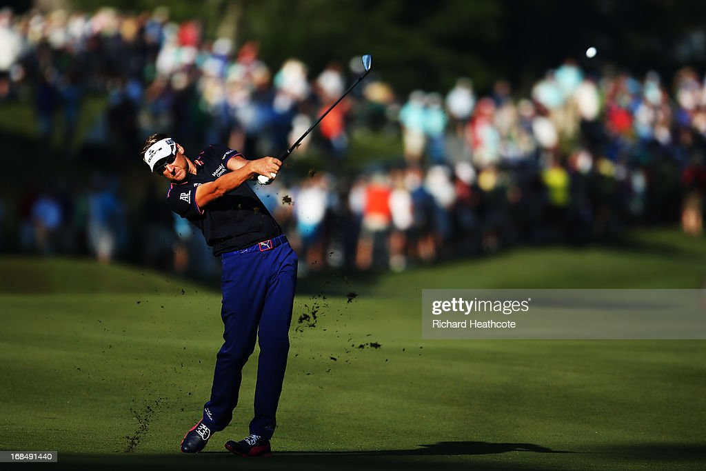 <a gi-track='captionPersonalityLinkClicked' href=/galleries/search?phrase=Ian+Poulter&family=editorial&specificpeople=171444 ng-click='$event.stopPropagation()'>Ian Poulter</a> of England plays his second shot on the 10th hole during round two of THE PLAYERS Championship at THE PLAYERS Stadium course at TPC Sawgrass on May 10, 2013 in Ponte Vedra Beach, Florida.
