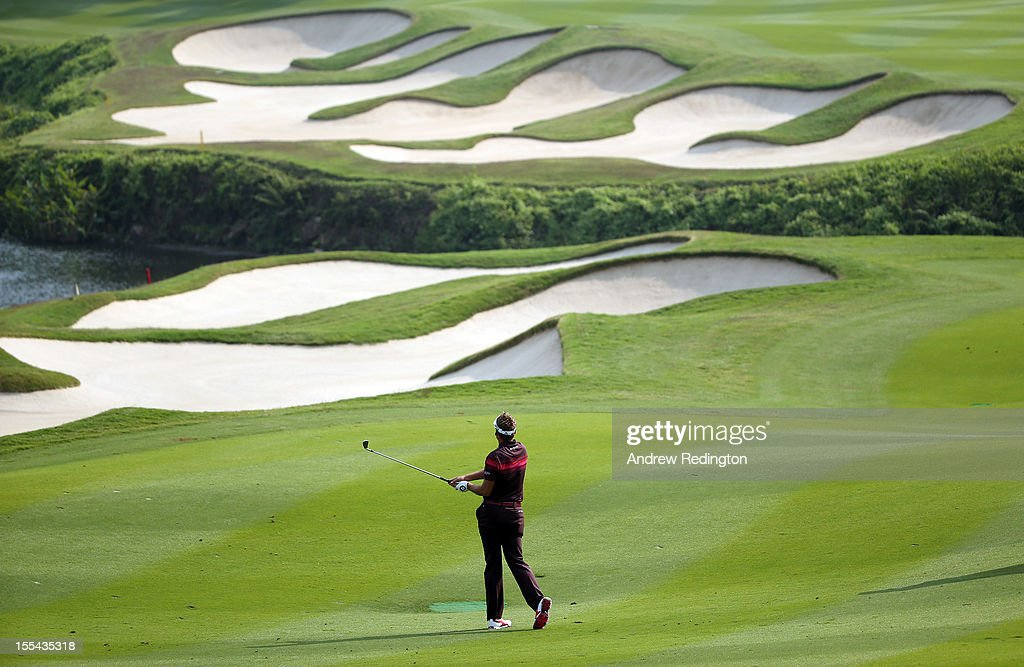 Ian Poulter of England plays his second shot on the 15th hole during the final round of the WGC HSBC Champions at the Mission Hills Resort on November 4, 2012 in Shenzhen, China.