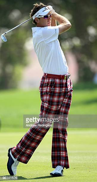Ian Poulter of England plays his second shot on the fifth hole during the final round of The Abu Dhabi Golf Championship at Abu Dhabi Golf Club on...