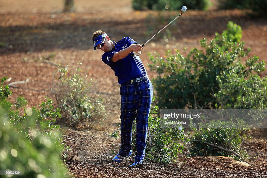 <a gi-track='captionPersonalityLinkClicked' href=/galleries/search?phrase=Ian+Poulter&family=editorial&specificpeople=171444 ng-click='$event.stopPropagation()'>Ian Poulter</a> of England plays his second shot on the par four 12th hole during the first round of the 2012 DP World Tour Championship on the Earth Course at Jumeirah Golf Estates on November 22, 2012 in Dubai, United Arab Emirates.