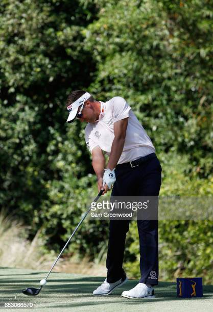 Ian Poulter of England plays his shot from the 11th tee during the final round of THE PLAYERS Championship at the Stadium course at TPC Sawgrass on...