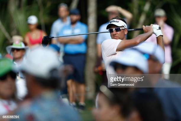 Ian Poulter of England plays his shot from the 15th tee during the final round of THE PLAYERS Championship at the Stadium course at TPC Sawgrass on...