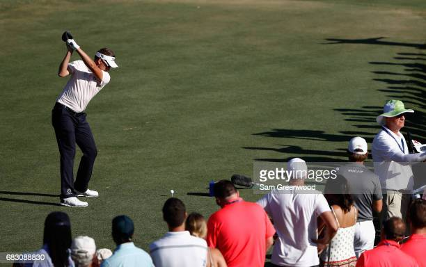 Ian Poulter of England plays his shot from the 16th tee during the final round of THE PLAYERS Championship at the Stadium course at TPC Sawgrass on...