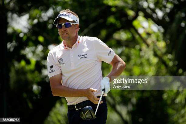 Ian Poulter of England plays his shot from the fifth tee during the final round of THE PLAYERS Championship at the Stadium course at TPC Sawgrass on...