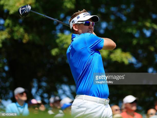 Ian Poulter of England plays his shot from the first tee during the final round of the RBC Canadian Open at Glen Abbey Golf Club on July 30 2017 in...