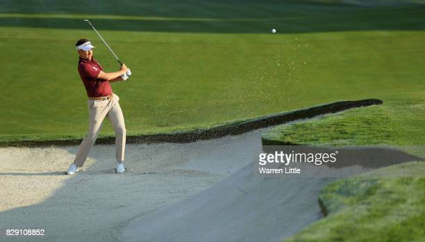 Ian Poulter of England plays his shot out of the bunker on the 10th hole during the first round of the 2017 PGA Championship at Quail Hollow Club on...