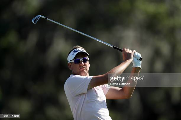 Ian Poulter of England plays his tee shot on the 12th hole during the final round of the THE PLAYERS Championship on the Stadium Course at TPC...