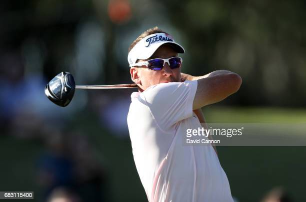 Ian Poulter of England plays his tee shot on the 16th hole during the final round of the THE PLAYERS Championship on the Stadium Course at TPC...
