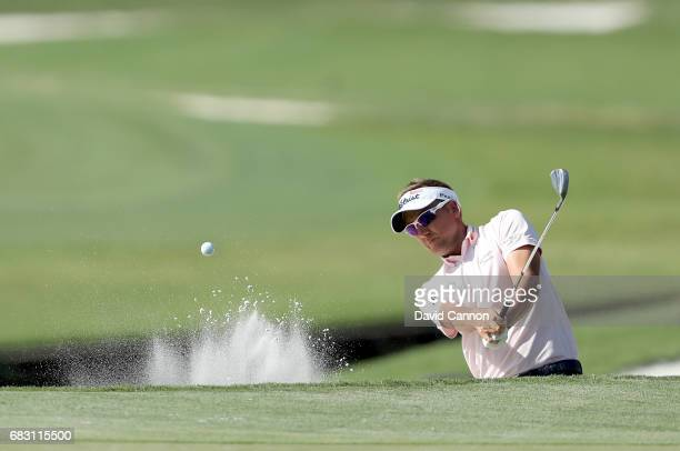 Ian Poulter of England plays his third shot on the 11th hole during the final round of the THE PLAYERS Championship on the Stadium Course at TPC...