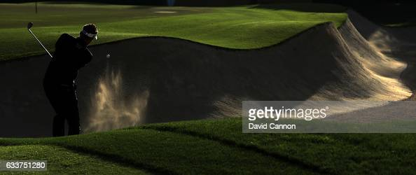 Ian Poulter of England plays his third shot on the par 5 10th hole during the completion of the weather delayed second round of the 2017 Omega Dubai...