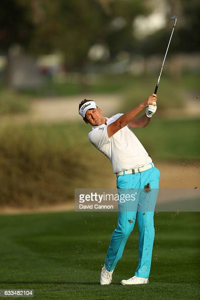 Ian Poulter of England plays his third shot to the par 5 10th hole during the first round of the 2017 Omega Dubai Desert Classic on the Majlis Course...