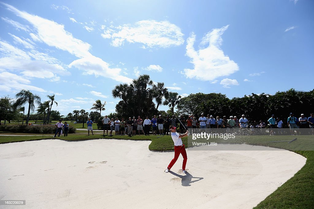Ian Poulter of England plays out of a bunker during a practice round ahead of the WGC - Cadillac Championship at the Doral Golf Resort & Spa on March 6, 2013 in Miami, Florida.