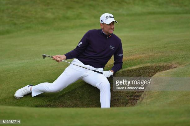 Ian Poulter of England plays out of a bunker on the 7th hole during the first round of the 146th Open Championship at Royal Birkdale on July 20 2017...