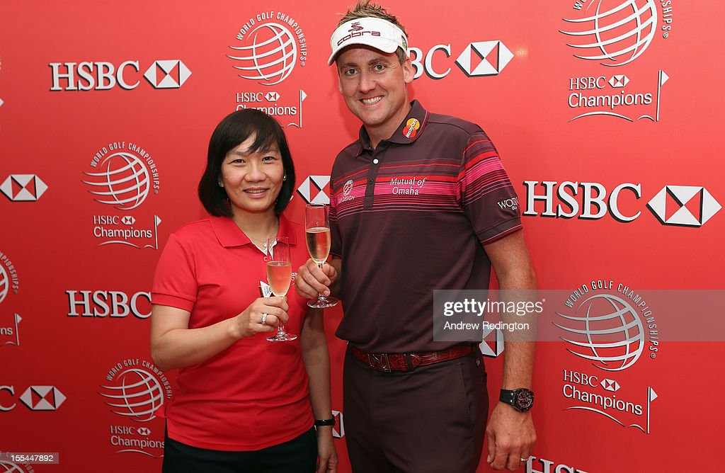 Ian Poulter of England poses with the trophy beside HSBC's Helen Wong after winning the WGC HSBC Champions during the final round at the Mission Hills Resort on November 4, 2012 in Shenzhen, China.