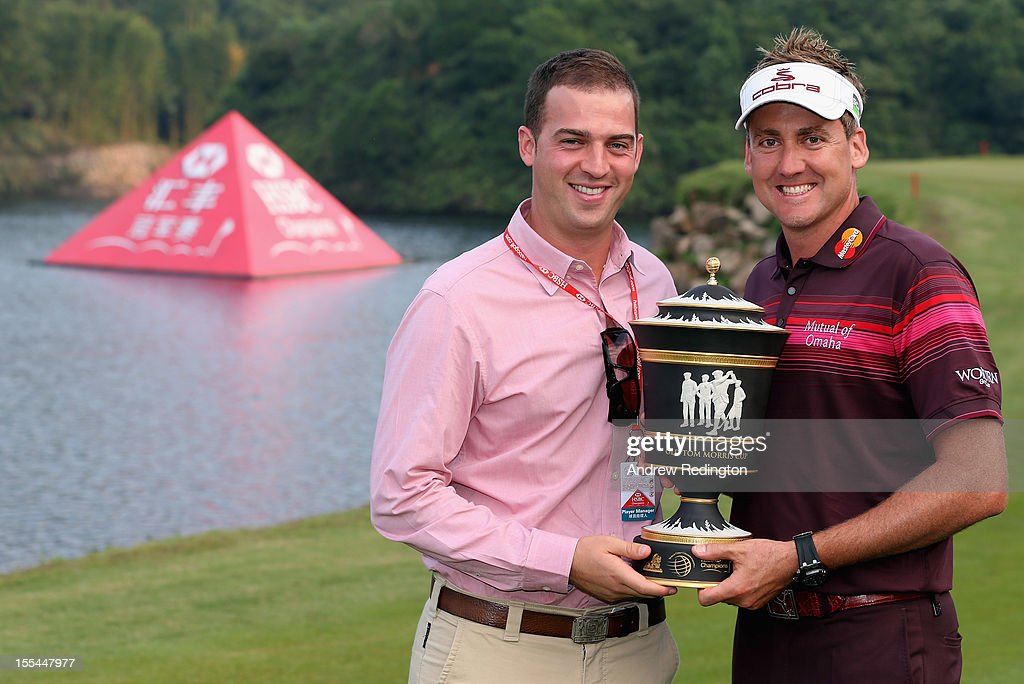 Ian Poulter of England poses with the trophy beside James Dunkley from his management team after winning the WGC HSBC Champions during the final round at the Mission Hills Resort on November 4, 2012 in Shenzhen, China.
